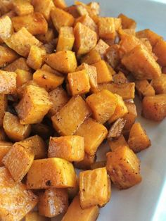 Roasted maple cinnamon sweet potatoes are a healthier side dish for dinner or Thanksgiving. Diced sweet potatoes are covered in a delicious marinade of olive oil, real maple syrup, spices, cinnamon and roasted to perfection in the oven. Baked Red Potatoes, Cubed Sweet Potatoes, Roasted Sweet Potatoes, Roasted Potato Recipes, Sweet Potato Recipes, Tortellini, Healthy Vegan Snacks, Healthy Recipes, Sweet Potato Cinnamon
