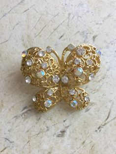 A personal favorite from my Etsy shop https://www.etsy.com/listing/248906627/vintage-butterfly-brooch-gold-rhinestone