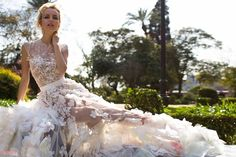 Oksana Mukha is a world-renowned European designer of couture wedding dresses, bridal gowns and evening gowns. Beautiful dresses by Oksana Mukha may be found at their wedding salons in Lviv, Ukrain…