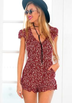 This summer, a busy girl just can�t have enough rompers, such as this red ditsy…