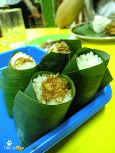 Nasi uduk is rice cooked with coconut milk, this is how they are displayed wrapped in coconut leaves before being put in the plate with other food you choose to accompany it.