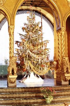 A vintage photo shows Margorie M. Post's Christmas tree in front of the living room windows at Mar-A-Lago.