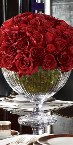 Stunning centerpiece, of red roses in crystal.