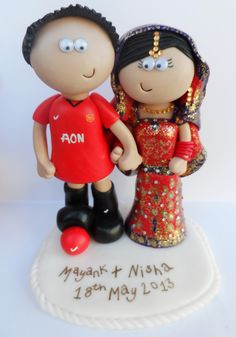 Manchester United Groom and Traditional Asian Bride personalised wedding cake topper, I can make whatever football kit you like and any other outfits www.googlygifts.co.uk