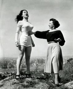 A young actress has voice lessons on a hilltop, 1950s.....she could put a eye out!!!