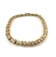 New to VintageVegasGems on Etsy: Sparkling Clear Rhinestone and Gold Tone Tennis Bracelet (14.00 USD)