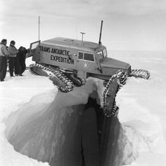 A Tucker Sno-Cat balanced precariously over a crevice, during the Trans-Antarctic Expedition, 1955-1958