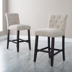 Morgana Tufted Counter Stool - A tailored look for your tall standing conversation table, the Morgana Tufted Counter Stool adds style and comfort. This stool stands at counter height...