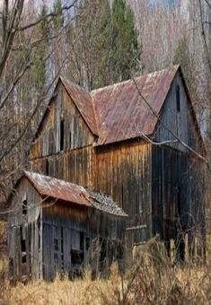 .Old barn with peaked roof by roxie
