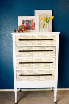 Tile your dresser drawers with wood rectangles. For a playful look, use old Scrabble tiles or dominoes instead.