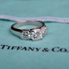 This gorgeous Tiffany three stone engagement ring features amazing high quality Lucida diamonds. The center diamond is a carat and the two carat accents are The ring is crafted of platinum and engraved with the Tiffany hallmarks. Engagement Ring Buying Guide, Engagement Rings Cushion, Unique Diamond Engagement Rings, Cheap Engagement Rings, Three Stone Engagement Rings, Perfect Engagement Ring, Three Stone Rings, Diamond Wedding Rings, Pic Saint Loup