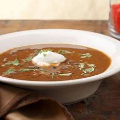 Black Bean Soup recipe - one of our family favorites.  We set a bag of tortilla chips, bowl of shredded cheese, sour cream and fresh cilantro on the table for dipping and crumbling in the soup.  Yum.