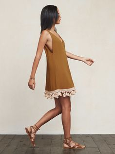 You should probably be in Morocco right now. The Taurus Dress is a great option for when you're on vacation, or just when you'd like to feel like you're on vacation. This is a loose-fitting, ghost crepe mini dress with a plunging neckline and back. The hem is also lined with tassels so feel free to give them a little shake. That's kind of what they're there for.   https://www.thereformation.com/products/taurus-dress-malt?utm_source=pinterest&utm_medium=organic&utm_campaign=PinterestOwnedPins