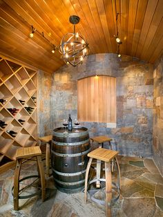 A very simple and clean wine cellar! Great use of wood throughout to create a classic and aged feel! What a great addition for any home and the simplicity and classic style make it appreciated by all!
