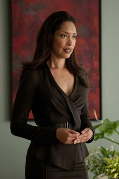 Jessica Pearson in Suits (this outfit with a cream undershirt)