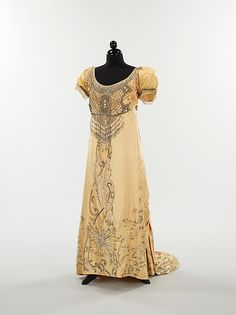 Embroidered pale yellow silk evening dress with rhinestone decoration (front), by Mme. Besancon de Wagner for House of Drécoll, French, 1910.