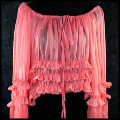 """D1 Coral Spanish Sheer Ruffle Off Shoulder Top ‼️PRICE FIRM‼️  Size Small Retail $359  This is an absolutely amazingly beautiful top!  You will get soooo  many compliments! Delicate sheer layers of ruffles adorn the body and sleeves.  Wear it as a scoop neck, a boat neck or off the shoulder. Ties in the front & you can adjust the neckline by how you tie it.  It is meant to be worn quite blousy and full. It will fit a range from a size 0-8.     Bust 48""""   Meant to be worn full and there is no…"""