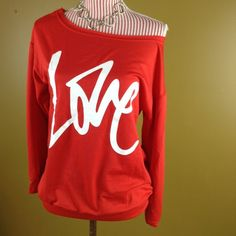 """Off-the-Shoulder Top Red slouchy, off the shoulder, """"LOVE"""" top. Not quite a sweatshirt but thicker than a t-shirt. Banded bottom. First pic reflects accurate color. Very cute fit. Brand new. Length: 24 inches Bust: 19 inches. ❌NO TRADES❌ Sweaters"""