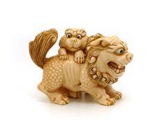 Foo dog and baby lion