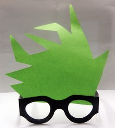Our mad scientist glasses and hair. We used die cut glasses and then cut out some crazy hair in paper usning fun neon colors. Glued the hair to the top of the glasses and the kids became mad scientist!  What an adorable idea!