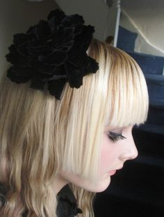 Blond girl with a classic hime cut.