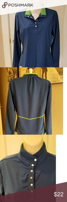 Nike golf shirt Nike long sleeve women's golf shirt. Blue with green accents, silver swoosh stamped snaps that bring the collar up to a mock turtle neck. Comfortable dri-fit nike quality sports wear.  Work hard,  play harder. Nike Tops Tees - Long Sleeve