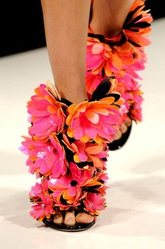 These are easy DIY shoes with a quick trip to Michael's for some silk flowers, hot clue and any old pair of shoes.