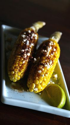 grilled sweetcorn on the cob, brushed with butter, sprinkled with chipotle chili pepper, feta cheese (to substitute for the queso cotija), served with a squeeze of lime.