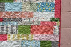 I like the variable clamshell quilting on this, as well as the improvised stripes.