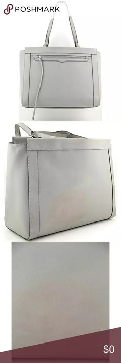 """Rebecca Minkoff Monroe Grey Leather Tote Rebecca Minkoff Grey Leather Monroe Purse Tote. In excellent condition with blemish from color transfer from carrying on back side.             Dust bag included. 🚫Pricing reflects flaw.                                         ⚫️DIMENSIONS: 14.5"""" W x 11.5"""" H x 4.5"""" D ⚫️SHOULDER STRAP DROP: 9.5 in.                          Carry your belongings with ease in the Monroe bag from Rebecca Minkoff . Made of quality Leather materials. Pictures are of actual…"""