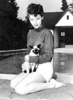 Ava Gardner with her siamese, 1946.