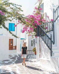 Downtown mykonos cobblestone streets and pink flowers white houses blue doors greek islands greece Greek Islands To Visit, Best Greek Islands, Greece House, Greek Town, Greek Island Hopping, Blue Doors, Walking Street, Romantic Vacations