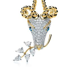 Jean Schlumberger was famous for his whimsical depictions of animals. This gazelle clip is composed of 18k gold and white diamonds with cabochon sapphire eyes. #JeanSchlumberger