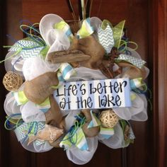 The deco mesh wreath would look great for all you lake-loving people--Life's Better at the Lake! It is accented with cattails, driftwood, fish, an anchor, a variety of ribbon and much more, **Available. Contact artmeetshome@aol.com if interested.