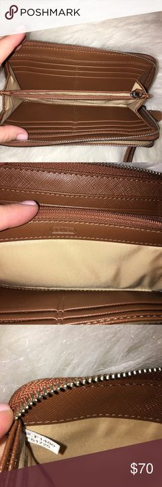 NWOT Coach large zip around wallet Excellent condition. Only sign of wear is one small mark on front which you can't even see without the flash camera (as photographed). No. F1480 F51725 Coach Bags Wallets
