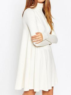 bcbdbeb6693f Casual swing dress featuring a turtleneck design that can be folded in half  or worn layered