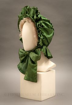 """""""Kate Greenaway"""" Silk Bonnet: circa 1880-1889. This emerald green bonnet is similar to one Kate Greenaway featured in Under the Window, Pictures and Rhymes for Children in 1878."""