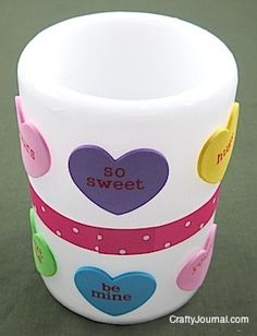 Easy kids Valentine's Day craft - stick conversation hearts and ribbon onto a candle!