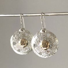 Round silver drop earrings with a gold plated dome in the centre. Add sparkle to your outfit with these silver earrings. Large range of silver jewellery. Silver Drop Earrings, Sterling Silver Earrings, Jewelry Design, Unique Jewelry, Silver Jewellery, Jewelry Collection, I Am Awesome, Artisan, Diamonds