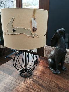 Hare lampshade handcrafted from a lovely linen/cotton blend fabric with hand painted and appliqued hares.