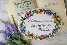 personalized house sign with pansies and quote from Shakespeare's Hamlet.