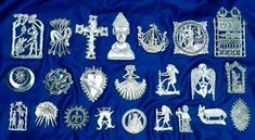"Pilgrim Badges. In the Middle Ages, people who went on pilgrimages would buy these badges to show others where they had made their pilgrimages and as a memento of their journey. In England, many badges have been found in the river Thames, so it's thought that this may have been a sort of ""good luck"" or holy tradition."