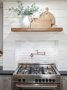 The new kitchen gets some trademark Joanna Gaines touches like white shiplap walls and plenty of open shelving.