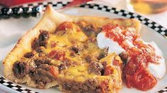 Deep-Dish Taco Pizza | This family-pleasing dish is a cross between a pizza and a casserole, and guaranteed to please even the pickiest of eaters.