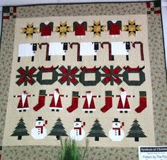 I like this row quilt with a plain, consistent background
