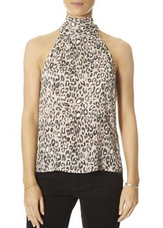 New this season, the 'Frida' Leopard Print Halter Neck Top features a halter neck closure and the silk-blend feels so good against the skin. Team yours with another print or keep it simple with denim. SHOP NOW! Yellow Short Sleeve Tops, Short Sleeves, Long Sleeve, Yellow Shorts, White Shorts, Women's Tops, Tank Tops, Halter Neck, Fashion Ideas