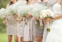 bridesmaids in unmatching dresses and babys breath bouquets.. LOVE it!!