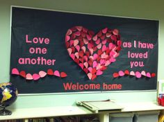 """February 2013 St. Stephen Catholic Community Teacher Resource Room bulletin board. I used construction paper die cut hearts, folded in half, and stapled to the bulletin board. The """"Welcome Home"""" refers to a homily given by Fr. John that all are welcome here."""