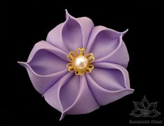 Purple fabric origami flower for TJ and Christine's wedding. - MJ (10/6/12)