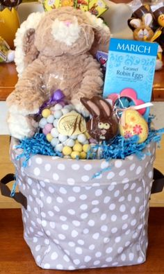 31 Mini Utility Tote with various Easter goodies including Ganz cute and fuzzy loveable bunny.